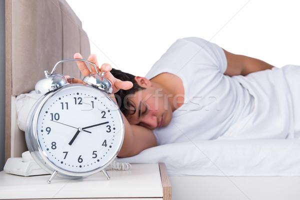 Homme lit souffrance insomnie horloge dormir Photo stock © Elnur