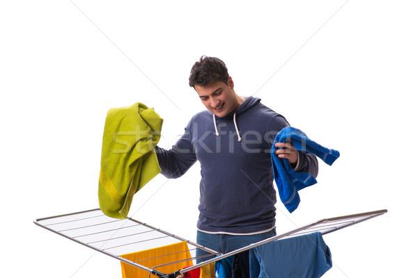 Husband man doing laundry isolated on white Stock photo © Elnur