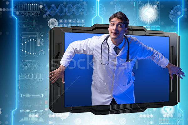 The telemedicine concept with doctor and smartphone Stock photo © Elnur