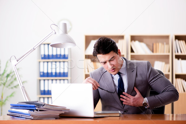 Businessman feeling pain in the office Stock photo © Elnur