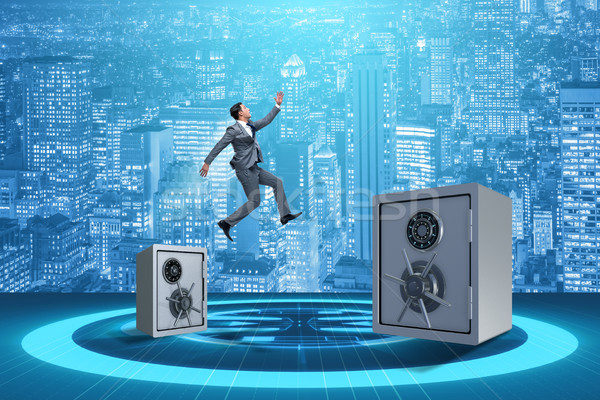 Businessman jumping from safes in business concept Stock photo © Elnur
