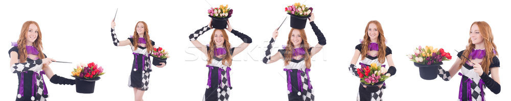 Magician woman with flowers on white Stock photo © Elnur