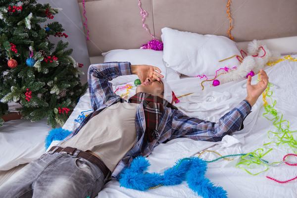 Człowiek cierpienie kac christmas strony działalności Zdjęcia stock © Elnur
