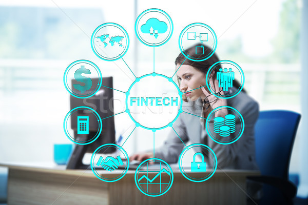Businesswoman with computer in financial technology fintech conc Stock photo © Elnur