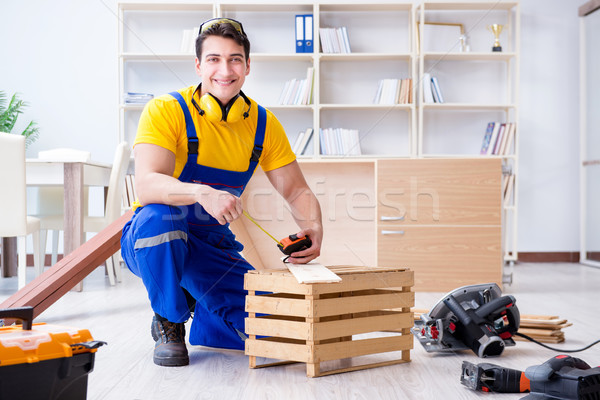Repairman carpenter working with wooden board plank and measurin Stock photo © Elnur