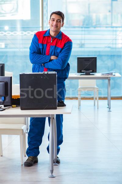 Computer technician repairing broken computer in workshop Stock photo © Elnur