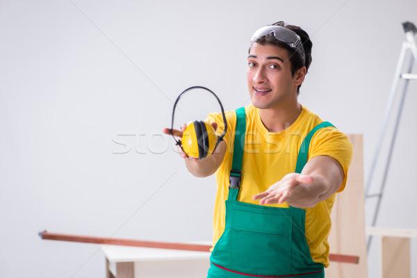 Travailleur bruit heureux casque Photo stock © Elnur