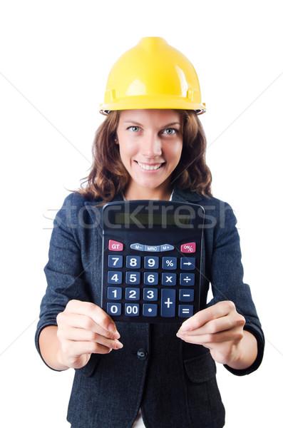 Female builder with calculator on white Stock photo © Elnur