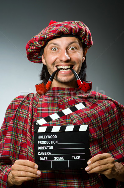 Funny scotsman with movie board and smoking pipe Stock photo © Elnur