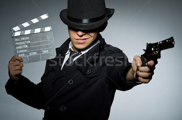 Giovane arma grigio imprenditore gun film Foto d'archivio © Elnur