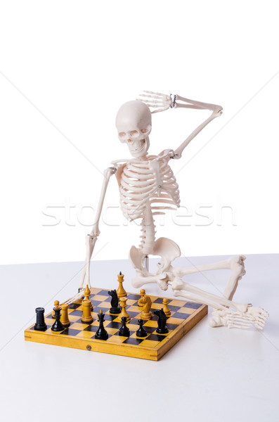 Csontváz játszik sakk játék fehér kéz Stock fotó © Elnur