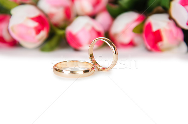 Wedding Rings And Flowers Isolated On White Background Stock