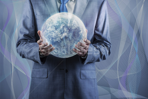 Businessman holding earth in global concept Stock photo © Elnur