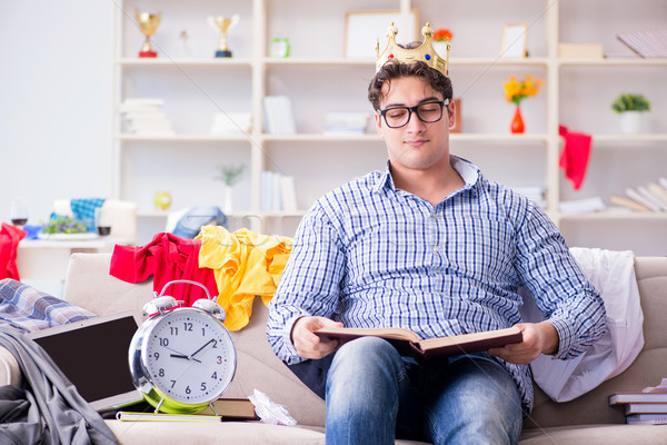 Stock photo: Young man working studying in messy room