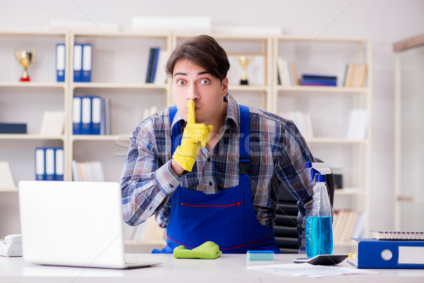 The male cleaner working in the office Stock photo © Elnur