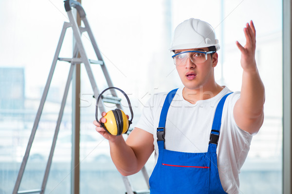 Young worker with noise cancelling headphones Stock photo © Elnur