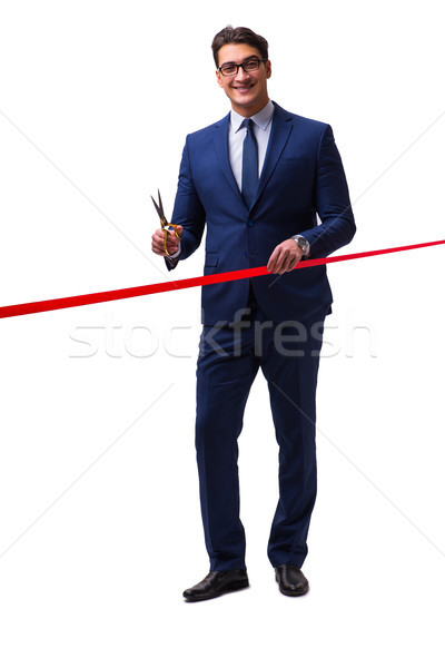 Businessman cutting red ribbon isolated on white Stock photo © Elnur