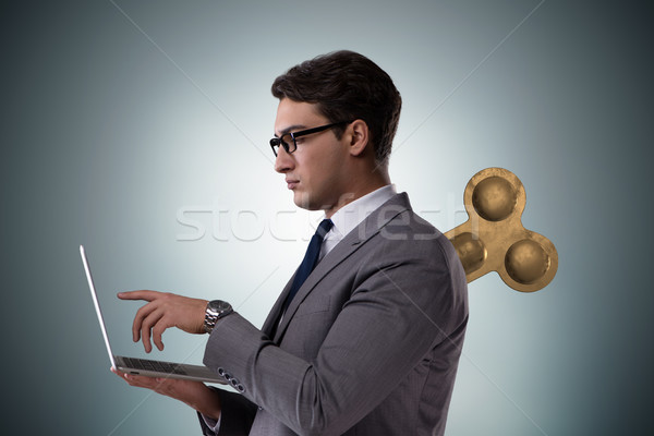 Businessman with key in hardworking concept Stock photo © Elnur