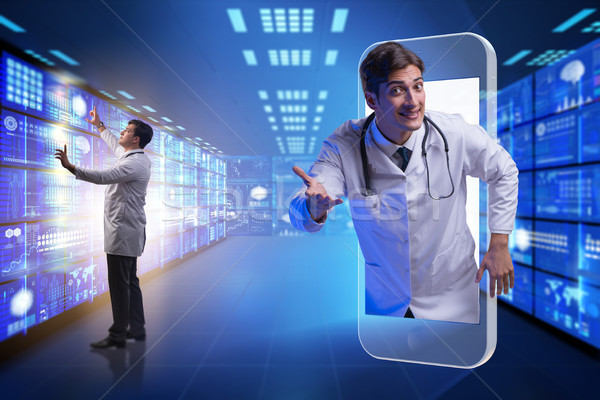 Telemedicine concept with doctor and smartphone Stock photo © Elnur