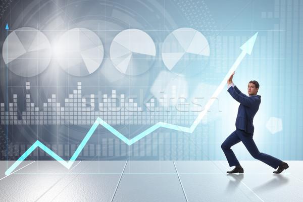 молодые бизнесмен экономический роста бизнеса диаграммы Сток-фото © Elnur