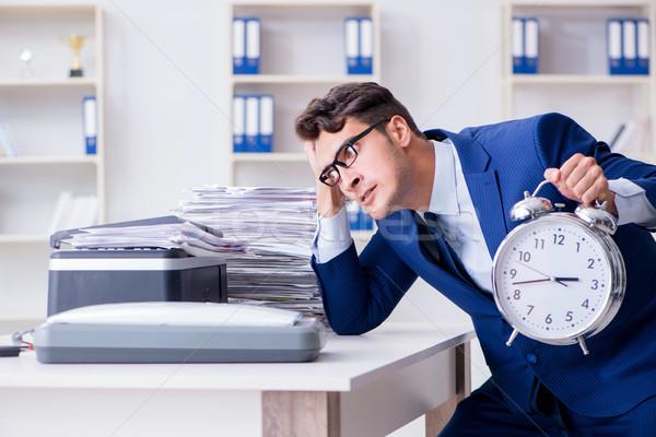 Businessman making copies in copying machine Stock photo © Elnur