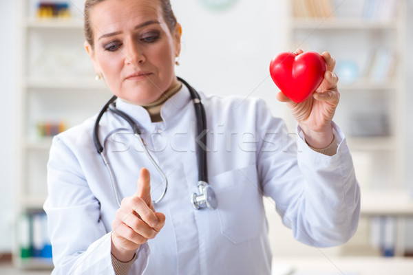 Cardiologist with red heart in medical concept Stock photo © Elnur