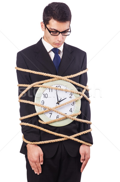 Businessman tied to clock on white Stock photo © Elnur