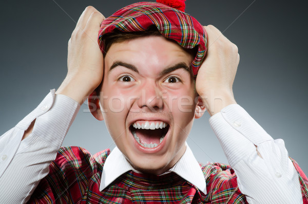 Funny scotsman in the studio shooting Stock photo © Elnur