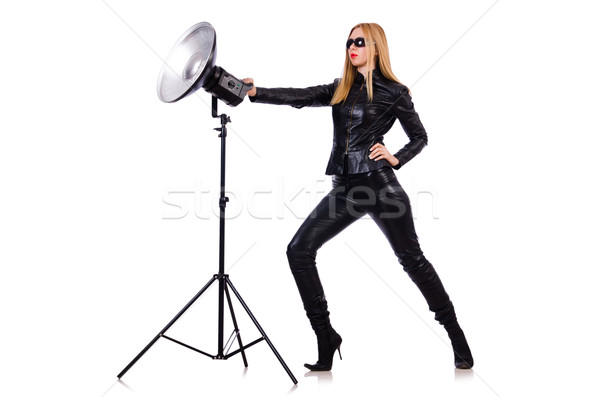 Woman in black leather dress in studio shootout Stock photo © Elnur
