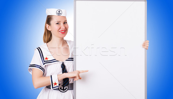 Woman sailor with blank board on white Stock photo © Elnur
