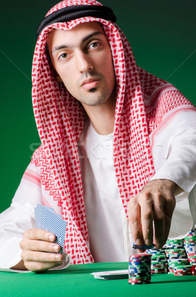Arab man playing in the casino Stock photo © Elnur