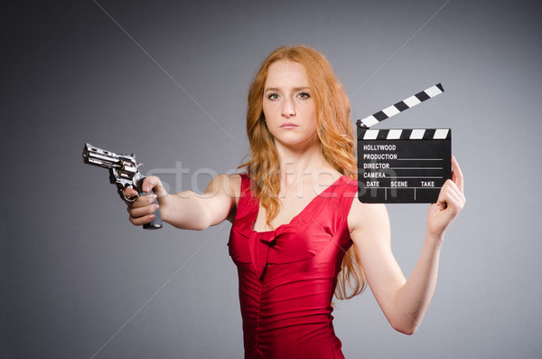 Pretty young girl in red dress with gun isolated on white Stock photo © Elnur