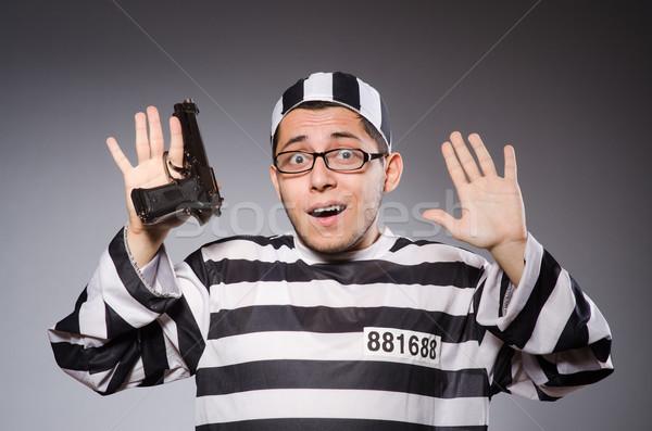 Stockfoto: Jonge · gevangene · handgun · grijs · man · portret