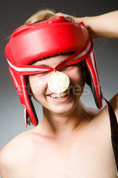 Stock photo: Funny boxer with winning gold medal