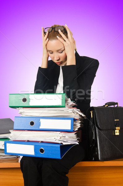 Woman with lots of work Stock photo © Elnur