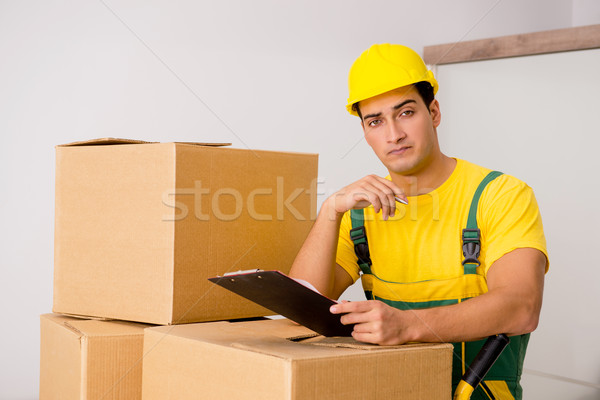 The man delivering boxes during house move Stock photo © Elnur