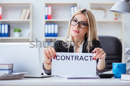 Businesswoman sitting at her desk in business concept Stock photo © Elnur