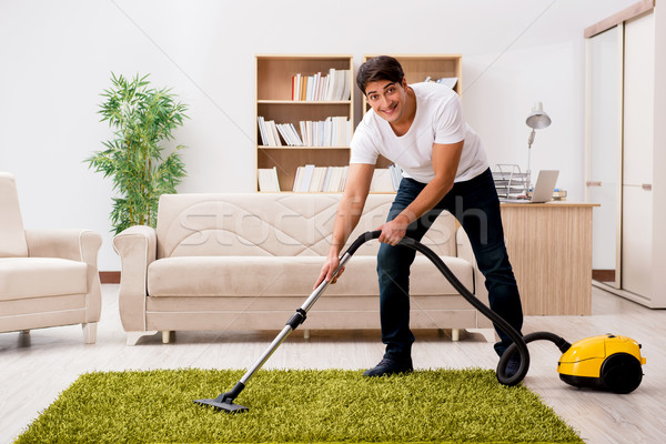 Man cleaning home with vacuum cleaner Stock photo © Elnur