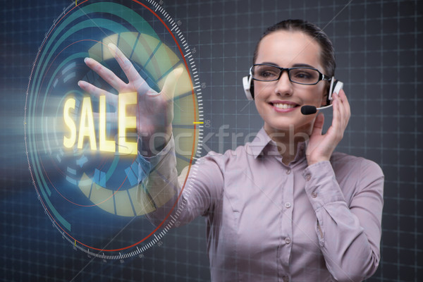 Telesales concept with woman pressing button Stock photo © Elnur