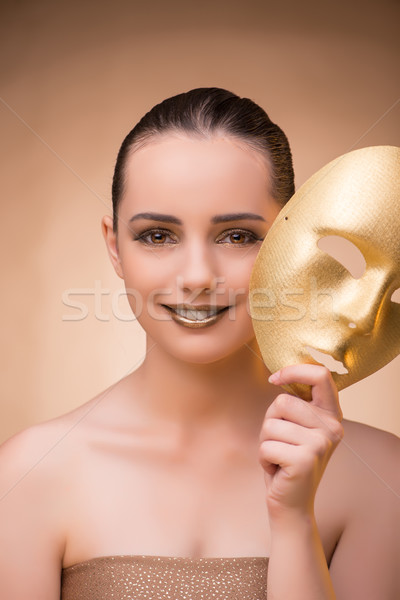 The young woman with mask in carnival concept Stock photo © Elnur