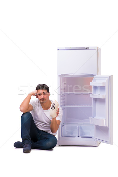 голодный человека глядя деньги холодильник бизнеса Сток-фото © Elnur