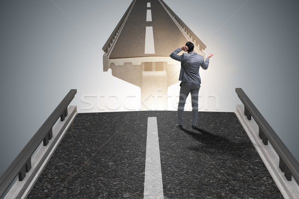 The young businessman in uncertainty concept with bridge Stock photo © Elnur
