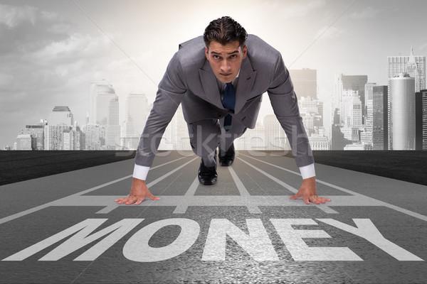 Empresário corrida dinheiro seguir negócio financiar Foto stock © Elnur