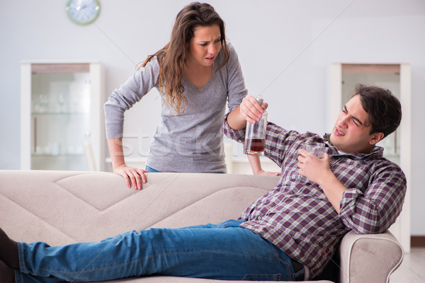 Drinking problem drunk husband man in a young family concept Stock photo © Elnur