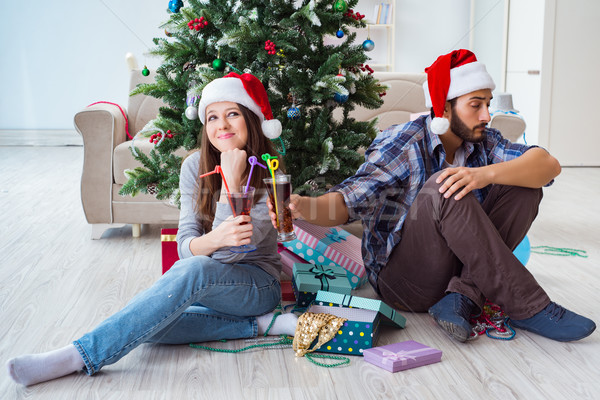 Young pair in conflict situation during christmas night Stock photo © Elnur