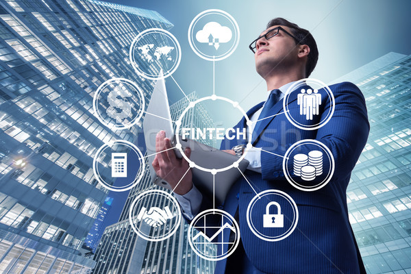 Businesswoman with laptop in financial technology fintech concep Stock photo © Elnur