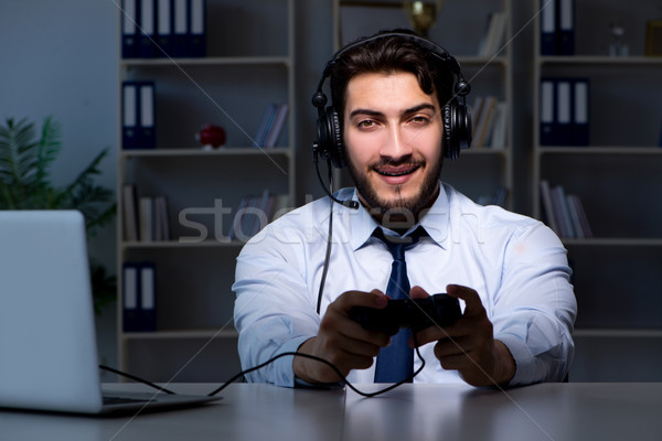 Businessman gamer staying late to play games Stock photo © Elnur
