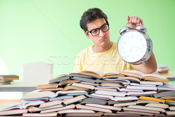 Student with too many books to read before exam Stock photo © Elnur