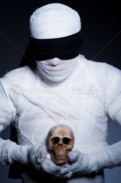 Mummy with skull in dark room Stock photo © Elnur