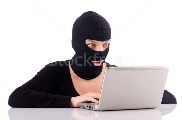 Hacker with computer wearing balaclava Stock photo © Elnur